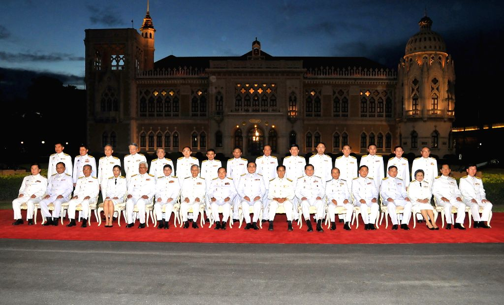 Thail Prime Minister Gen. Prayuth Chan-ocha (C front) poses for a group photo with his cabinet members at the government house in Bangkok, Thailand, Sept. 4, 2014. . - Gen