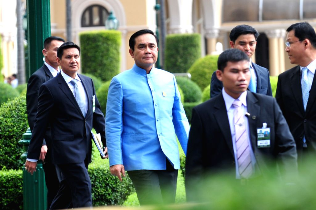 Thai military junta chief and newly-appointed Prime Minister General Prayuth Chan-ocha (3rd L) arrives for his first cabinet meeting at the Government House in ... - General Prayuth Chan