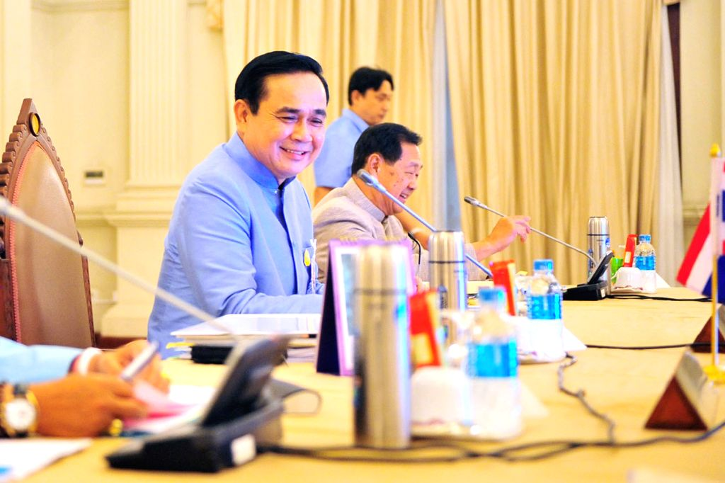 Thai military junta chief and newly-appointed Prime Minister General Prayuth Chan-ocha (L) holds his first cabinet meeting at the Government House in Bangkok, ... - General Prayuth Chan
