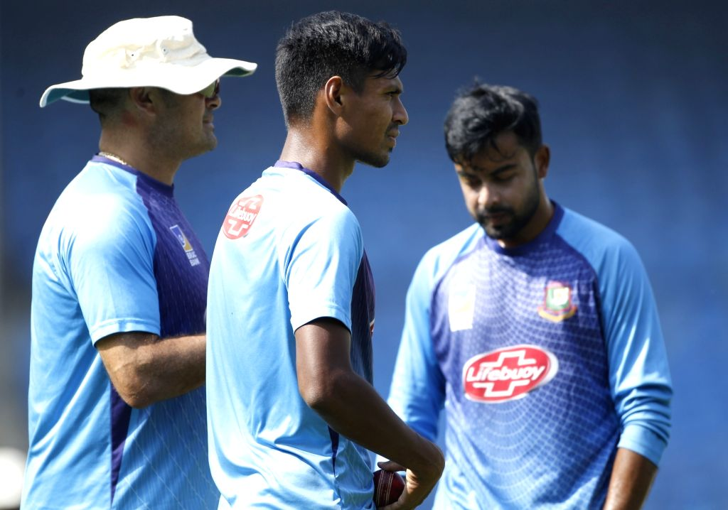 Bangladesh bowling coach Charl Langeveldt with cricketers Mustafizur Rahman and Abu Jared during a practice session ahead of the 1st Test match against India, at Holkar Cricket Stadium in ...