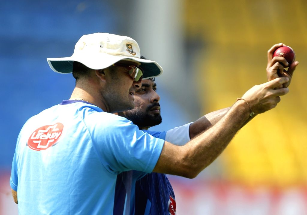 Bangladesh bowling coach Charl Langeveldt with cricketer Abu Jared during a practice session ahead of the 1st Test match against India, at Holkar Cricket Stadium in Indore, Madhya Pradesh on ...