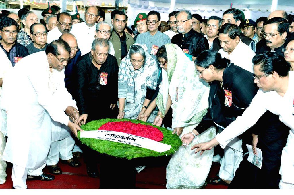 Bangladesh Prime Minister Sheikh Hasina and others pay tribute to the victims of `Aug 21 grenade attacks` at Bangabandhu Avenue in Dhaka, Bangladesh on Aug 21, 2014. - Sheikh Hasina