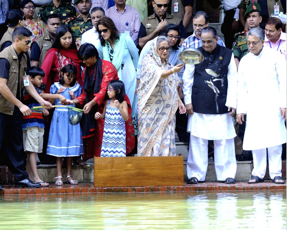 Bangladesh Prime Minister Sheikh Hasina releases minnows at a pond in Ganabhaban to mark the National Fisheries Week in Dhaka, Bangladesh on July 29, 2015. - Sheikh Hasina