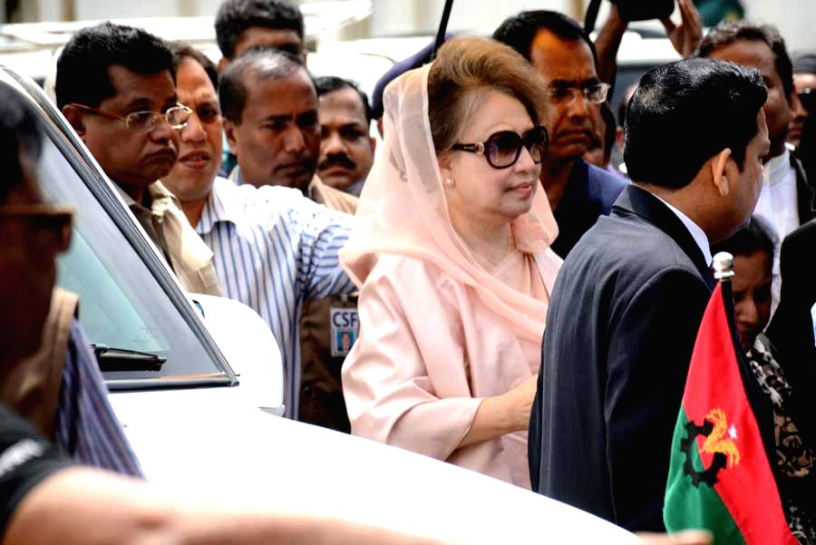 Bangladesh's former Prime Minister and Bangladesh Nationalist Party chairperson Khaleda Zia (2nd R, front) is seen after arriving at a court hearing of two graft cases ...