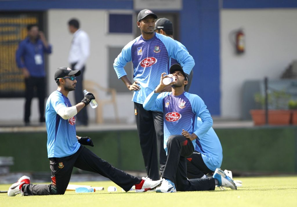 Bangladesh's M. Mithun, Al-Amin Hossain and Mehidy Hasan during a practice session ahead of the 1st Test match against India, at Holkar Cricket Stadium in Indore, Madhya Pradesh on Nov 12, ...