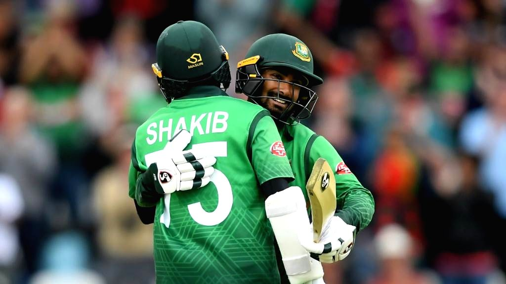Bangladesh's Shakib Al Hasan and Liton Das celebrate after winning the 23rd match of 2019 World Cup against West Indies at The Cooper Associates County Ground in Taunton, England on June 17, ...