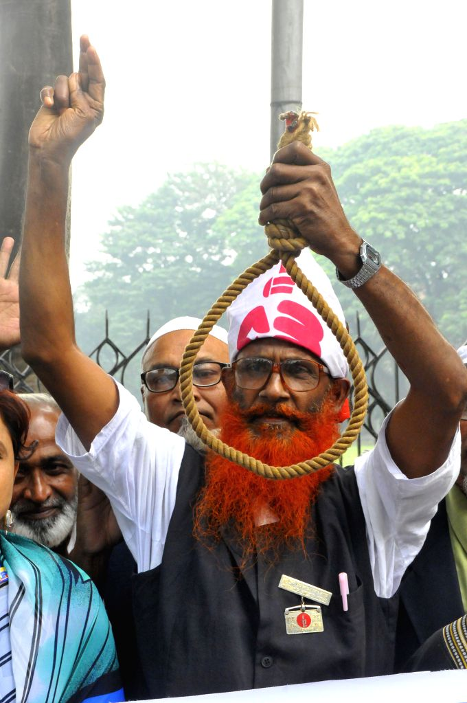 Bangladeshi activists and ruling party supporters attend a protest demanding death sentence, during the hearing for Secretary General of Bangladesh Jamaat-e-Islami ...