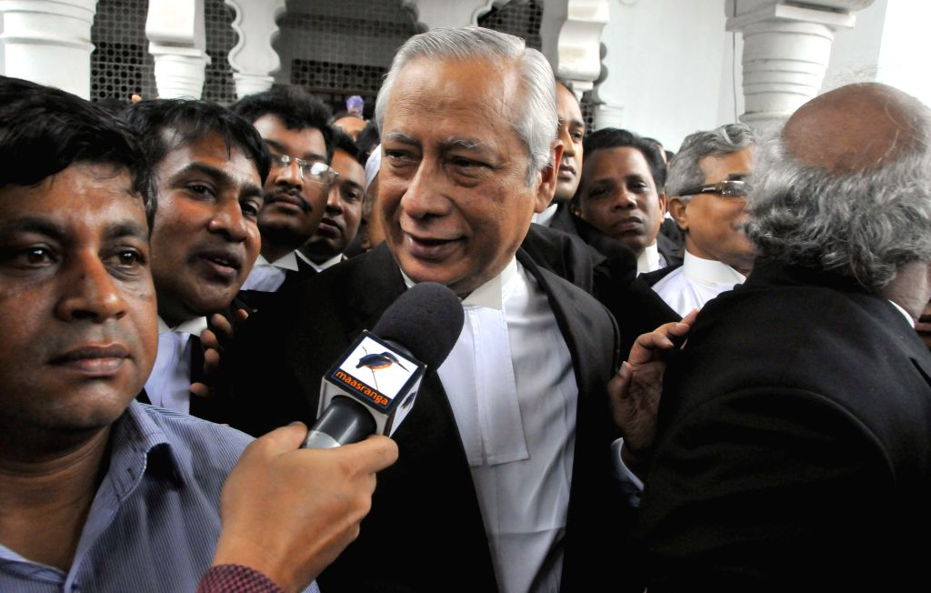Bangladeshi Attorney General Mahbubey Alam (C) speaks to media after the death penalty for a top opposition party leader was confirmed in Dhaka, Bangladesh, July 29, ...