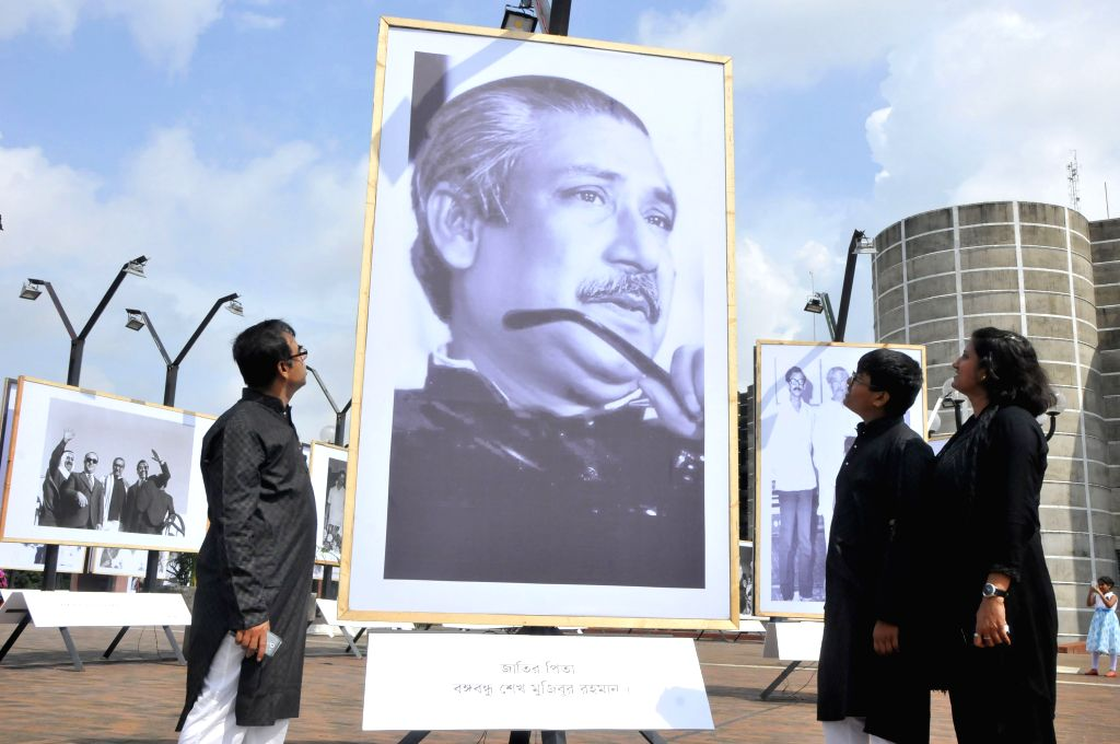 Bangladeshi people visit a historical photograph exhibition on Bangladesh's founding father and first president Sheikh Mujibur Rahman in Dhaka, Bangladesh, Aug. 15, ...