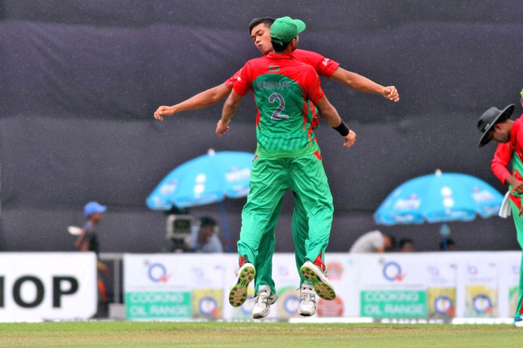 Bangladeshi players celebrate fall of a wicket during the third One Day International (ODI) match between India and Bangladesh at the Sher-e-Bangla National Cricket Stadium in Dhaka, Bangladesh on ...