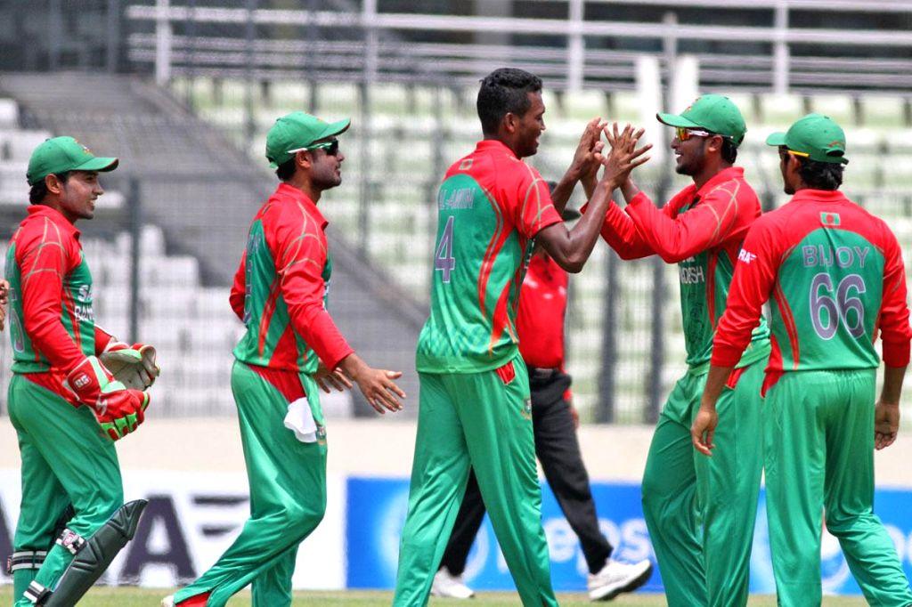 Bangladeshi players celebrate fall of Ajinkya Rahane's wicket during the third One Day International (ODI) match between India and Bangladesh at the Sher-e-Bangla National Cricket Stadium in Dhaka, ..