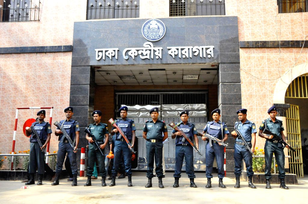Bangladeshi policemen stand guard in front of the central jail gate in Dhaka, Bangladesh, Nov. 19, 2015. Bangladesh's highest court has rejected appeals from two ...