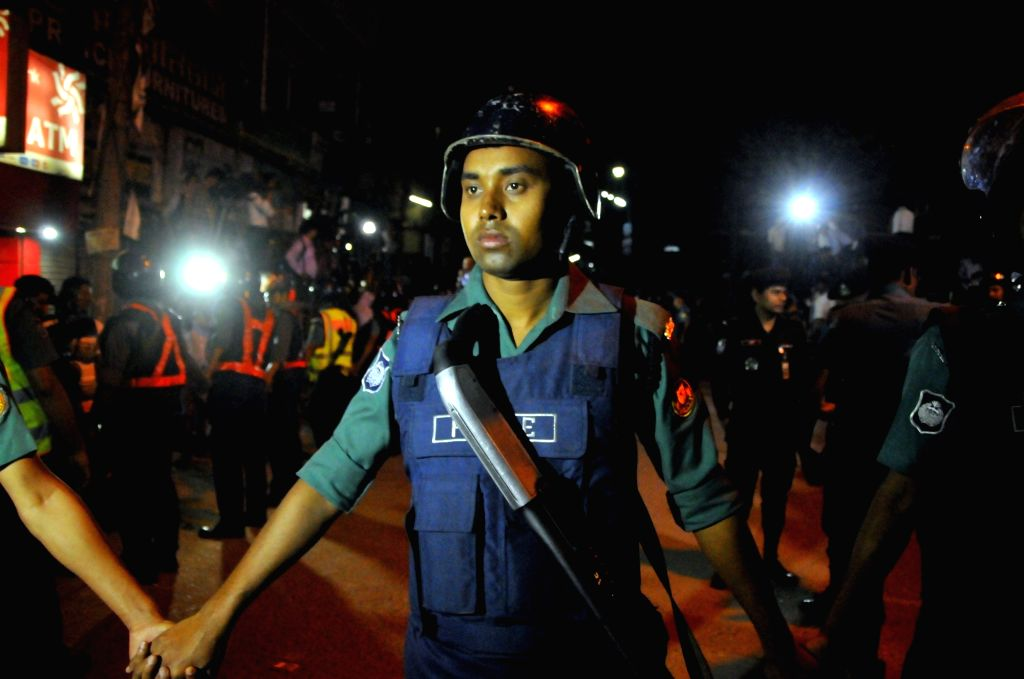 Bangladeshi policemen stand guard in front of the gate of the Central Jail before the execution of two opposition leaders convicted of war crimes in Dhaka, ...
