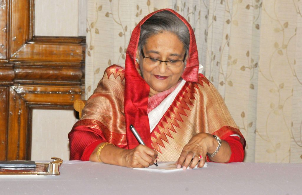 Bangladeshi Prime Minister Sheikh Hasina signs to issue a commemorative stamp and envelop at prime minister residence in Dhaka, Bangladesh, Oct. 17, 2015. China and ... - Sheikh Hasina