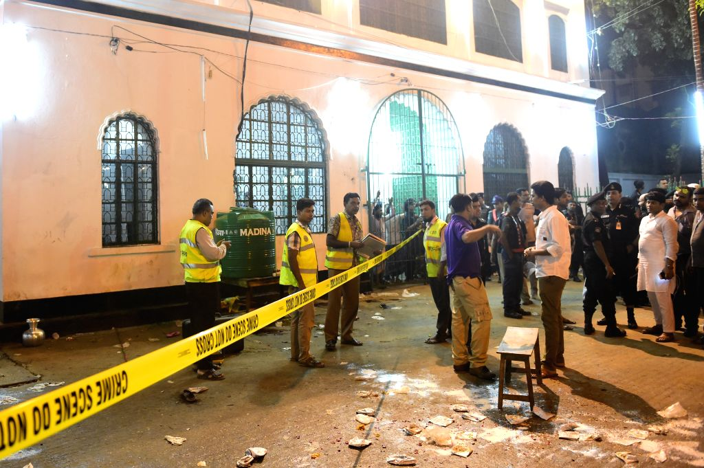 Bangladeshi security forces stand guard after bomb attacks in Dhaka, Bangladesh, Oct. 24, 2015. Bomb attacks on a shrine killed at least one person and injured dozens ...