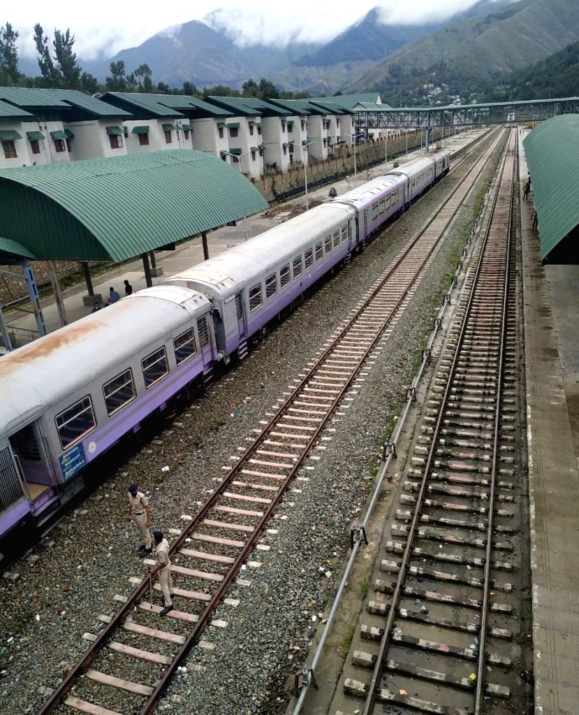 Banihal: The first glass-roofed air-conditioned train introduced in the Kashmir Valley in 2018 chugs off for shooting a documentary on the 137 km Banihal-Baramulla rail link during a special run of the vistadome or the glass-roofed coach for four day - Manoj Sinha