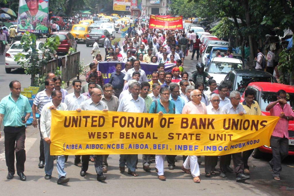 Bank employees affiliated to United Forum of Bank Unions (UFBU) stage a demonstration to protest against central government's policies for the banking sector, in Kolkata on July 29, 2016. ...