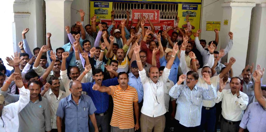 Bank employees affiliated to United Forum of Bank Unions (UFBU) stage a demonstration to protest against central government's policies for the banking sector, in Allahabad on July 29, ...