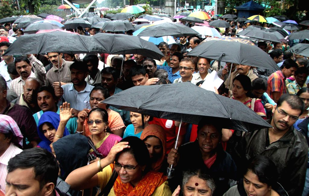 Bank employees affiliated to United Forum of Bank Unions (UFBU) stage a demonstration to protest against central government's policies for the banking sector, in Bengaluru on July 29, ...