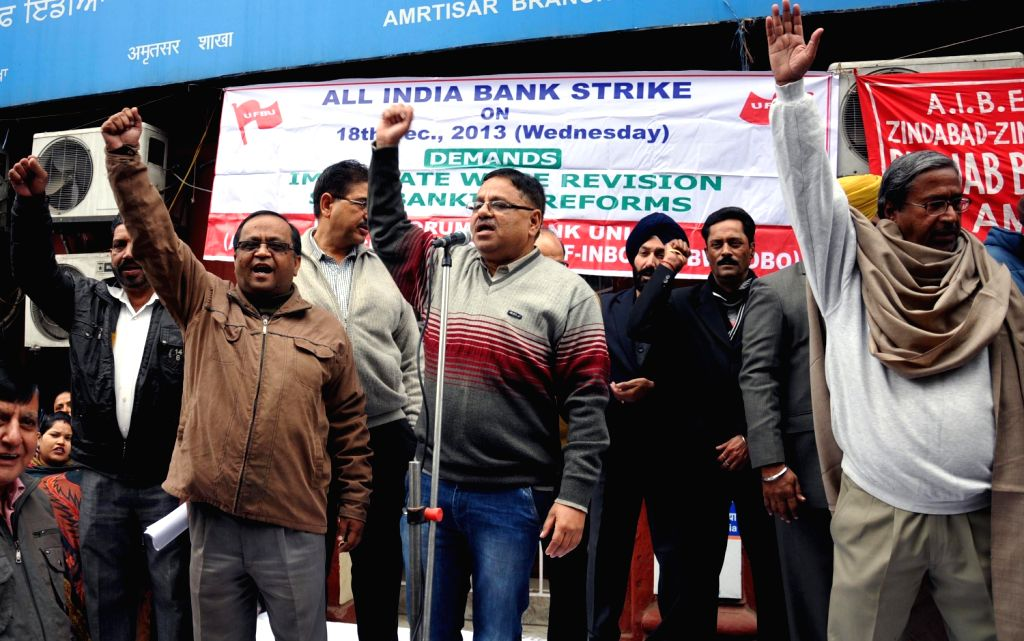 Bank Employees demonstrate during a day's strike called by them to press for their various demands in Bangalore on Dec.18, 2013.