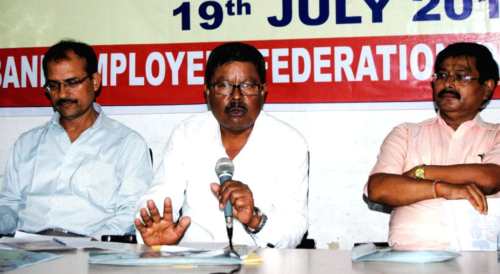 Bank Employees Federation (NER) General Secretary Dinesh Chandra Kakoty addresses a press conference on Bank Nationalisation Day in Guwahati on July 19, 2014.