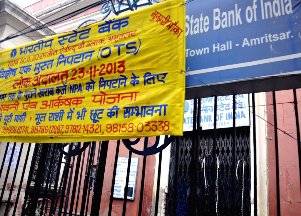 Banks remain closed as employees go on a day's strike to press for their various demands in Amritsar on Dec.18, 2013.