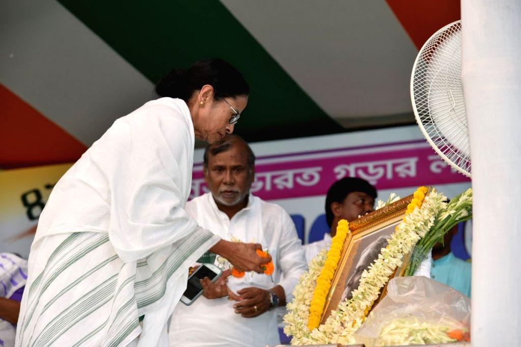 Bankura: West Bengal Chief Minister Mamata Banerjee pays tributes to Rabindranath Tagore on his birth anniversary, at a Trinamool Congress (TMC) rally in West Bengal's Bankura on May 9, 2019. (Photo: IANS) - Mamata Banerjee