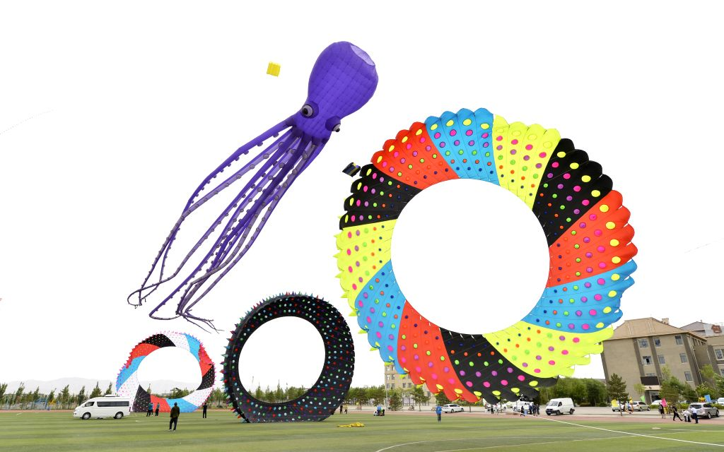BAOTOU, June 15, 2019 - Photo taken on June 15, 2019 shows a kite flying contest held in Baotou, north China's Inner Mongolia Autonomous Region.