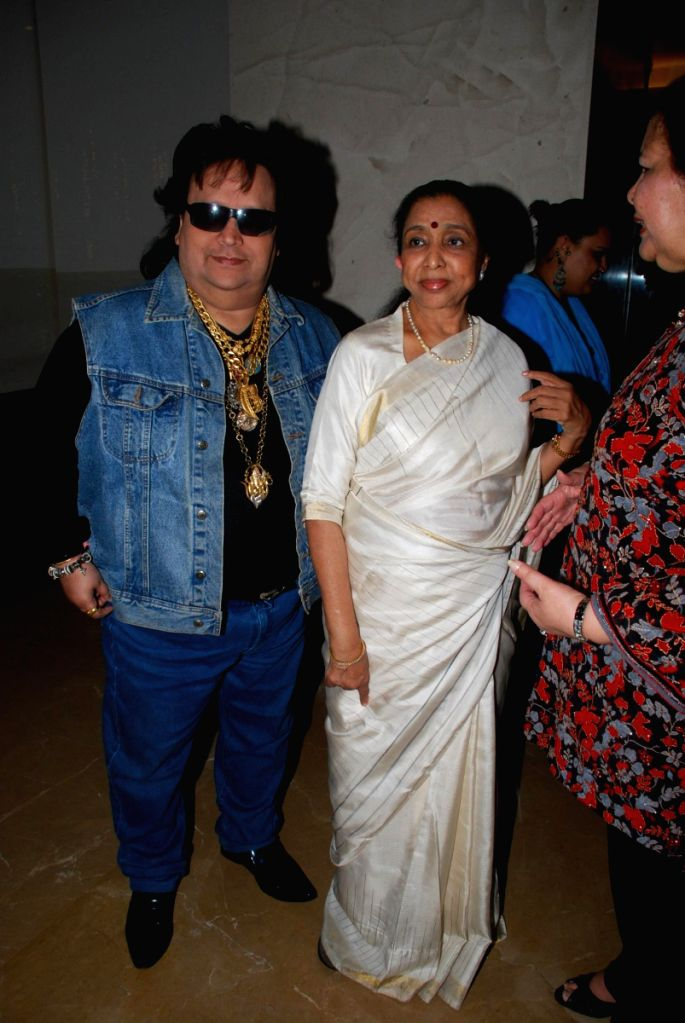 Bappi Lahiri and Asha Bhosle at Poonam Dhillon's birthday bash. - Asha Bhosle