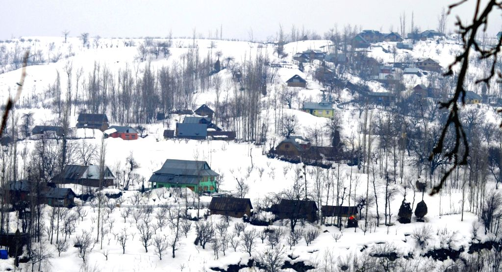 Baramulla: A view of snow covered houses in Kandi village of Baramulla district on Feb 20, 2019. (Photo: IANS)