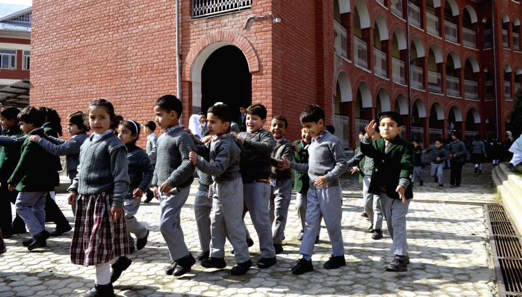 Baramulla: After a long winter recess, schools re-opened at Baramulla in Jammu and Kashmir on March 10, 2018. (Photo: IANS)