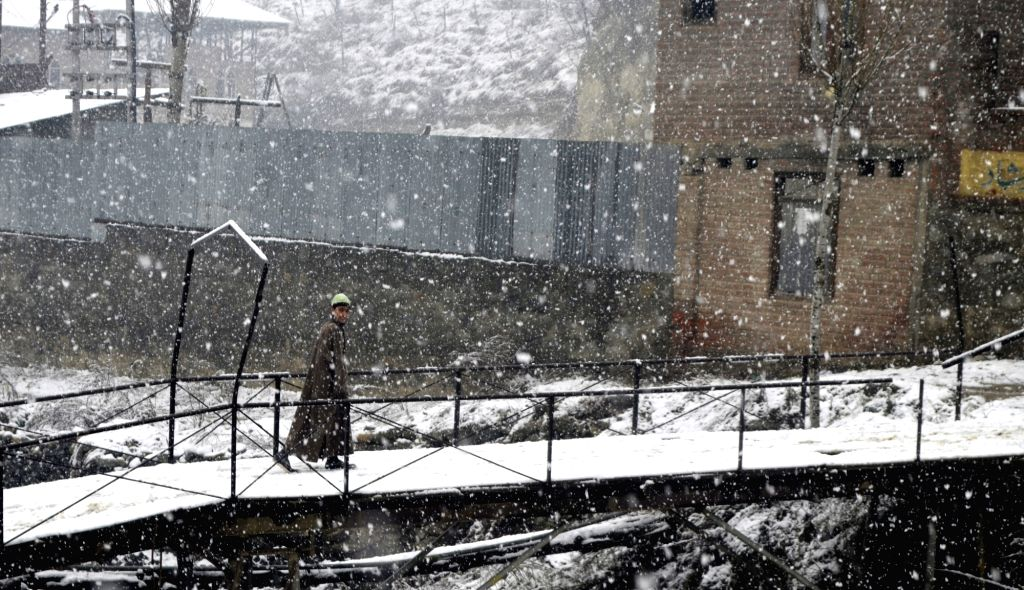 Baramulla in the Union Territory of Jammu and Kashmir receives fresh snowfall, on Dec 13, 2019.