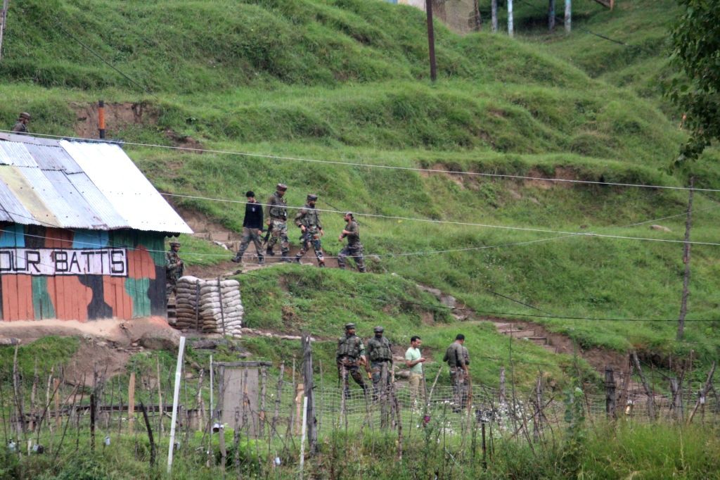 :Baramulla: Security personnel during cordon and search operations in the forest area of Rafiabad in Jammu and Kashmir's Baramulla district, on Aug 8, 2018. A gunfight started on Wednesday ...