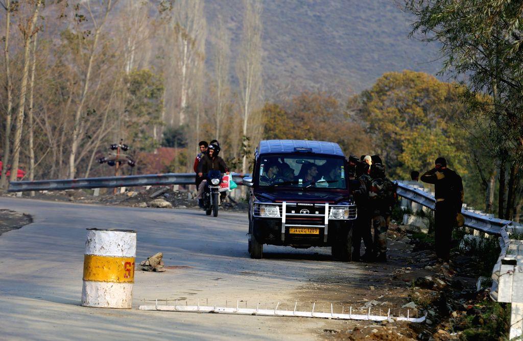 :Baramulla: Security personnel frisks vehicles at Sheeri at Srinagar-Muzzafarabad highway ahead of Prime Minister Narendra Modi`s visit in Jammu and Kashmir`s Baramulla district on Nov. 6, 2015. ... - Narendra Modi