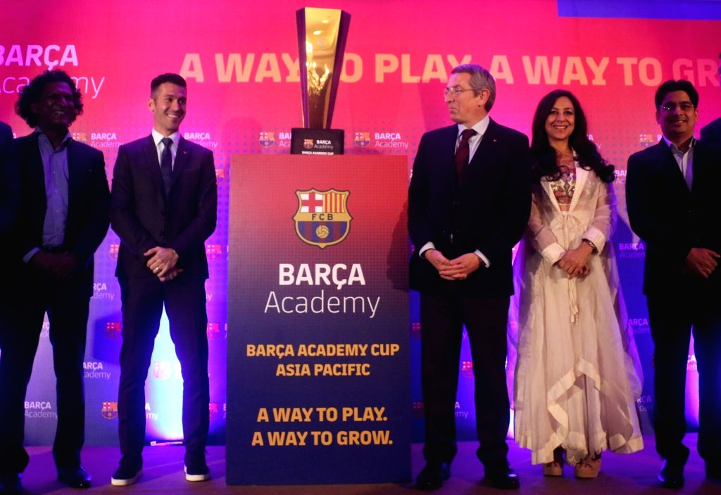 Barca Ambassador and Former FC Barcelona footballer Luis Garcia unveils the 2019 Asia-Pacific Soccer Cup trophy at a press conference, in New Delhi on Jan 24, 2019.