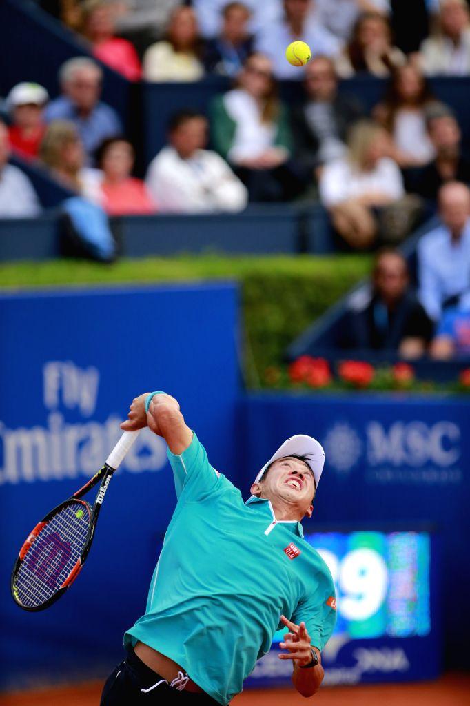 "Japan's Kei Nishikori serves during the final against Spain's Pablo Andujar at the ATP Barcelona Open ""Conde de Godo"" tennis tournament in Barcelona, ..."