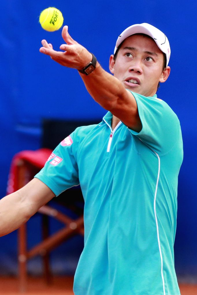 """Japan's Kei Nishikori serves the ball during the final against Spain's Pablo Andujar at the ATP Barcelona Open """"Conde de Godo"""" tennis tournament in ..."""