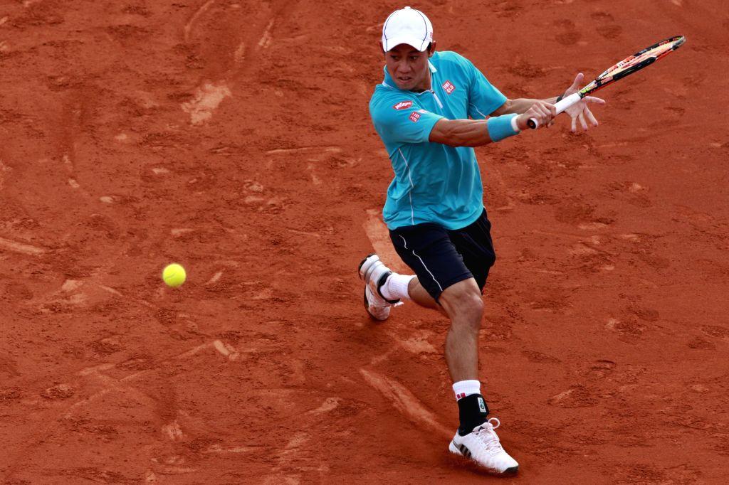 "Japan's Kei Nishikori returns a shot during the final against Spain's Pablo Andujar at the ATP Barcelona Open ""Conde de Godo"" tennis tournament in ..."