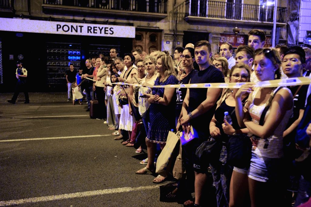 BARCELONA, Aug. 18, 2017 - A nearby street is cordoned off following a terrorist attack in central Barcelona, Spain, on Aug. 18, 2017. Thirteen people were confirmed dead and more than 100 others ...