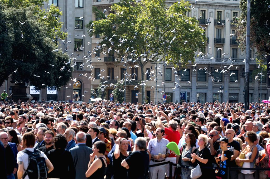 BARCELONA, Aug. 18, 2017 - People attend a gathering to mourn for terror attack victims at Placa Catalunya, Barcelona, Spain, on Aug. 18, 2017. The number of people killed in Thursday's double terror ...