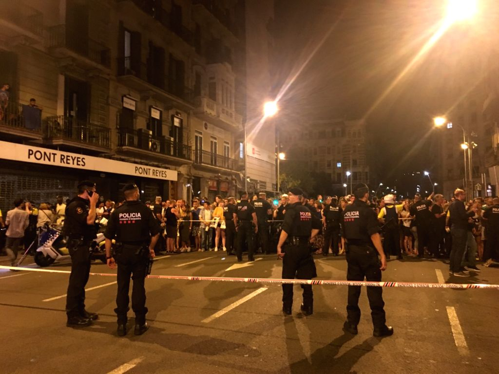 BARCELONA, Aug. 18, 2017 - Police cordon off a nearby street following a terrorist attack in central Barcelona, Spain, on Aug. 18, 2017. Thirteen people were confirmed dead and more than 100 others ...