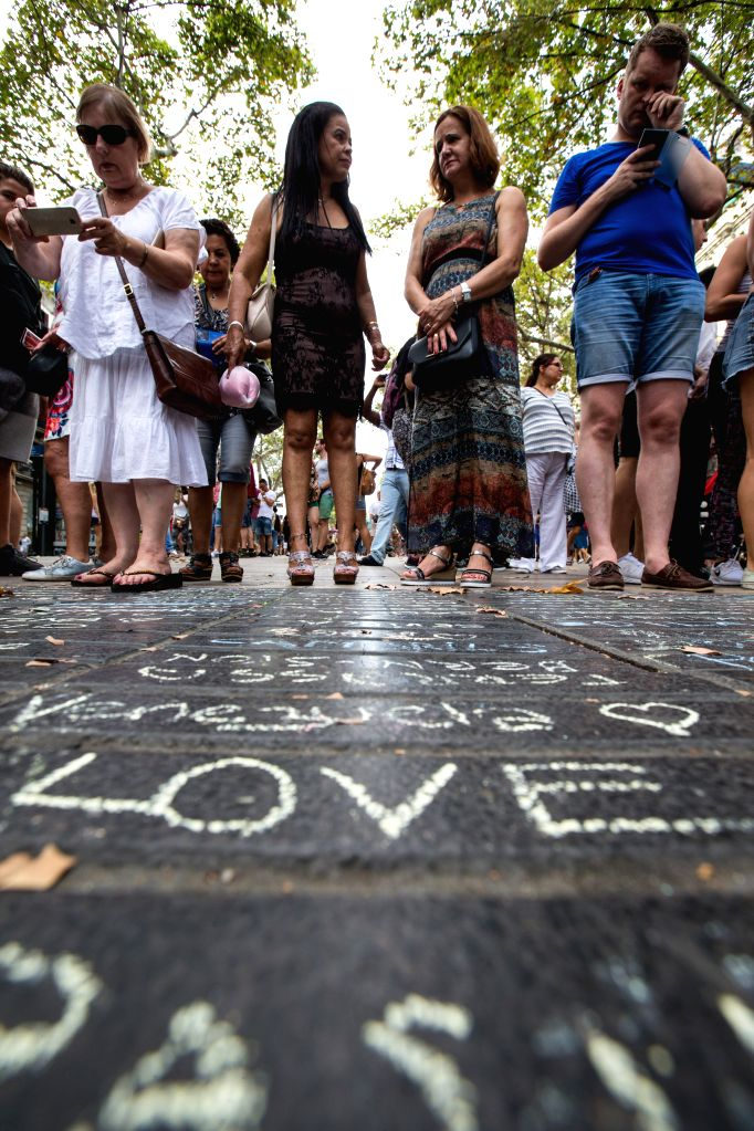 BARCELONA, Aug. 20, 2017 - Messages to mourn for victims in the terrorist attacks are written with chalks on the avenue in the Las Ramblas area of Barcelona, Spain, Aug. 19, 2017. The Spanish ...