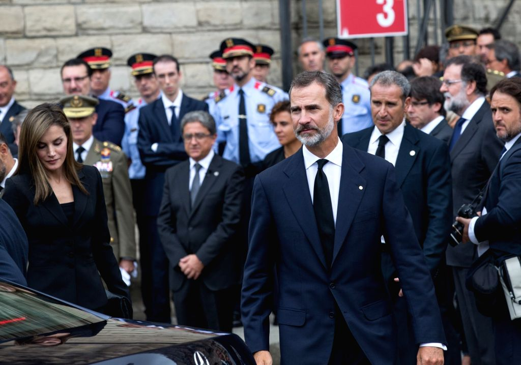 BARCELONA, Aug. 20, 2017 - Spain's King Felipe VI (front) leaves the Sagrada Familia after a mass to commemorate victims of two devastating terror attacks in Barcelona, Spain, on Aug. 20, 2017. A ...
