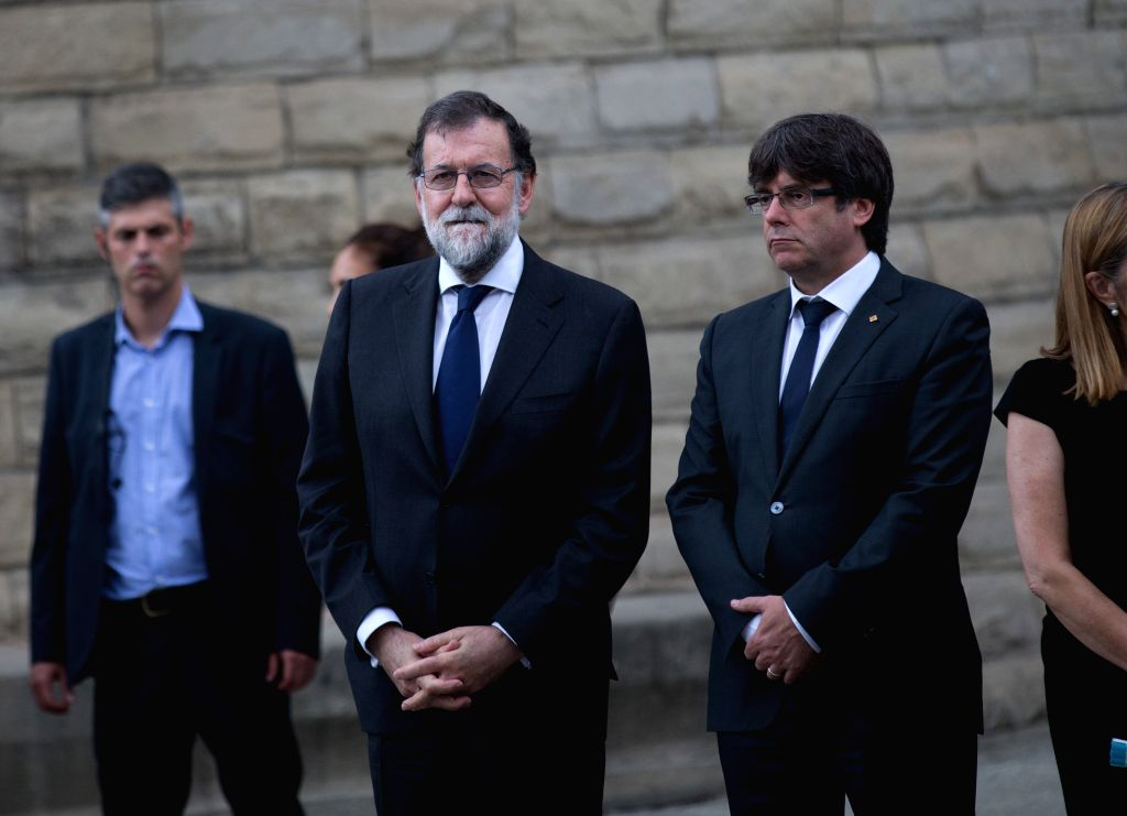 BARCELONA, Aug. 20, 2017 - Spain's Prime Minister Mariano Rajoy (L) stands in front of the Sagrada Familia before a mass to commemorate victims of two devastating terror attacks in Barcelona, Spain, ... - Mariano Rajoy