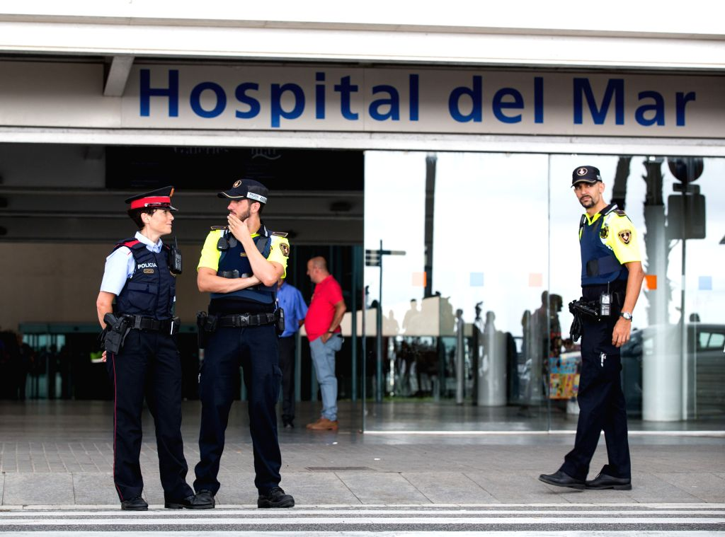 BARCELONA, Aug. 20, 2017 - Spanish policemen stand guard outside Hospital del Mar, where the injured are hospitalized in Barcelona, Spain, Aug. 19, 2017. The Spanish government decided to maintain ...