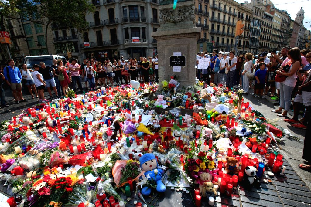 BARCELONA, Aug. 20, 2017 - Toys, flowers and candles are placed on the avenue to mourn for victims in the terrorist attacks in the Las Ramblas area of Barcelona, Spain, Aug. 19, 2017. The Spanish ...
