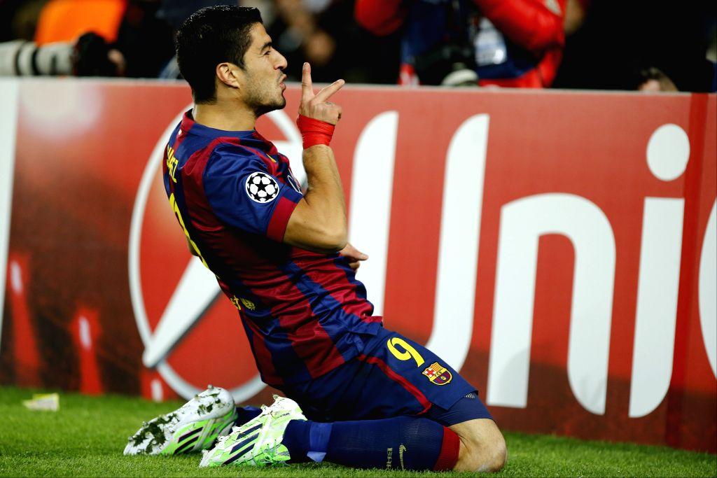 Barcelona's Luis Suarez celebrates scoring during the UEFA Champions League group F football match against Paris Saint-Germain in Barcelona, Spain, on Dec. 10, 2014. Barcelona won 3-1. ...