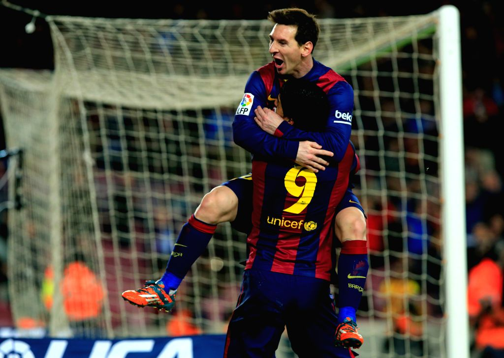 Barcelona's Lionel Messi (Top) celebrates his goal during the King's Cup semifinal first leg soccer match against Villareal at the Nou Camp Stadium in Barcelona, .