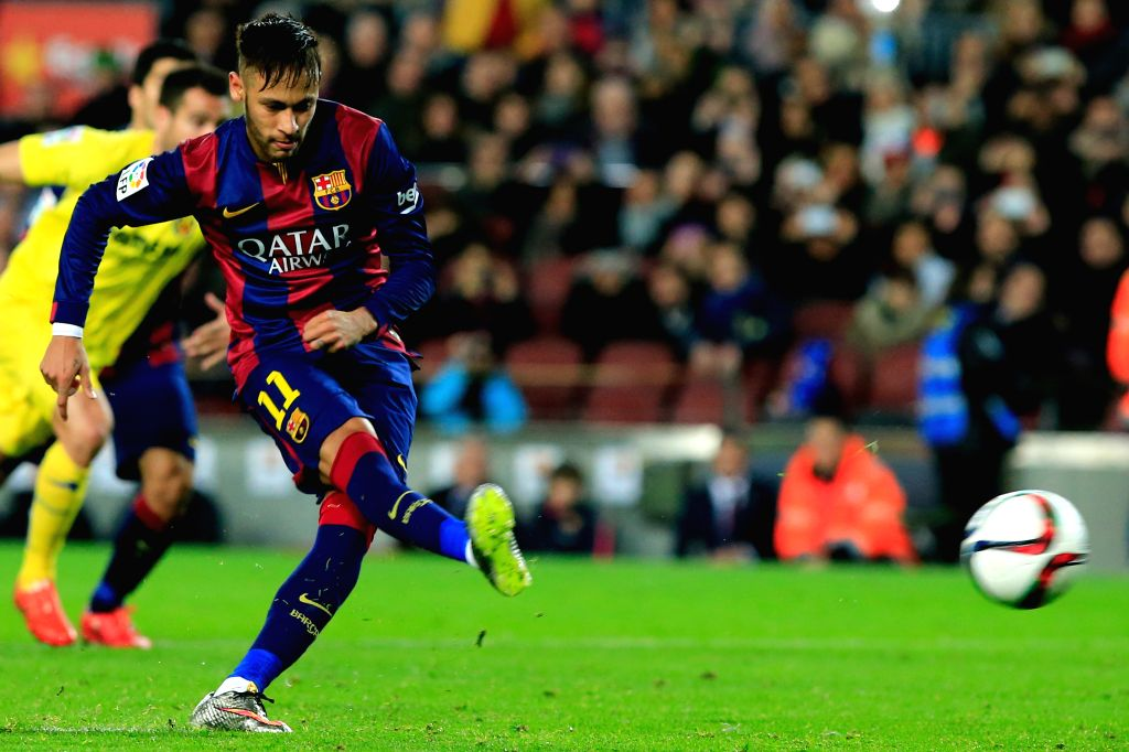 Barcelona's Neymar kicks and misses a penalty during the King's Cup semifinal first leg soccer match against Villareal at the Nou Camp Stadium in Barcelona, ...