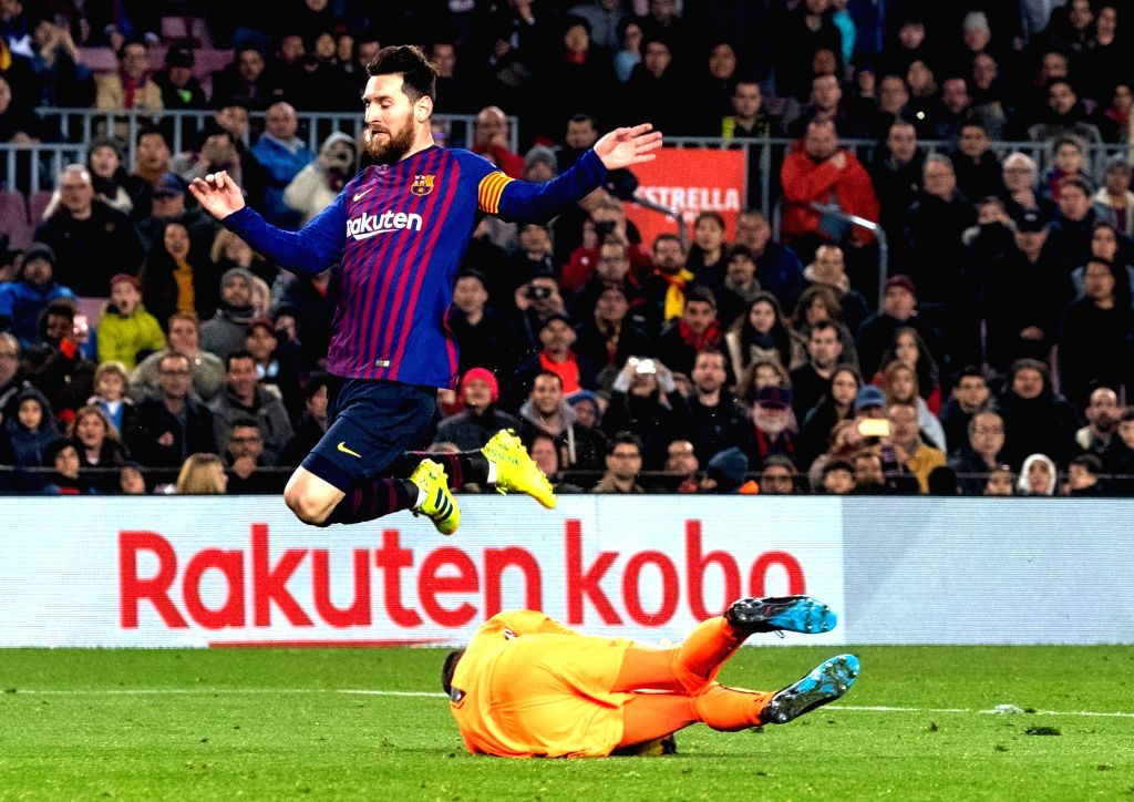 BARCELONA, Feb. 17, 2019 - Barcelona's Lionel Messi (L) competes with Valladolid's goalkeeper Jordi Masip during a Spanish league match between FC Barcelona and Valladolid in Barcelona, Spain, on ...